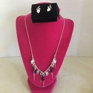 Silver tone leaf pendant necklace and earring set